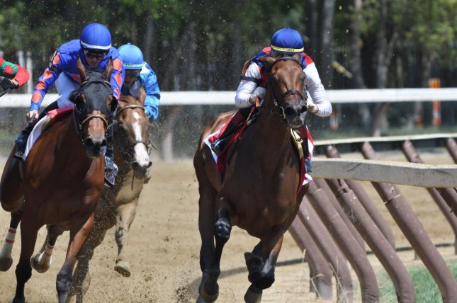 Guarana swings into the stretch en route to victory in Sunday's Coaching Club American Oaks at Saratoga, her third win from as many starts. Photo by Elsa Lorieul, courtesy of New York Racing Association