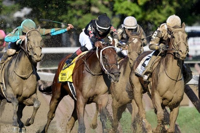 Eskimo Kisses (No. 2), seen en route to victory in the Grade I Alabama at Saratoga, is a key player in Sunday's Group 1 Spinster at Keeneland. (NYRA photo, Ariana Spadoni)
