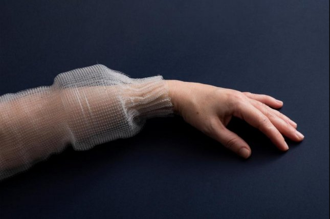 Scientists at MIT have created the first-ever digital fiber, which, when sewn into a shirt, can sense, story and analyze data. Photo byRoni Cnaani/MIT News