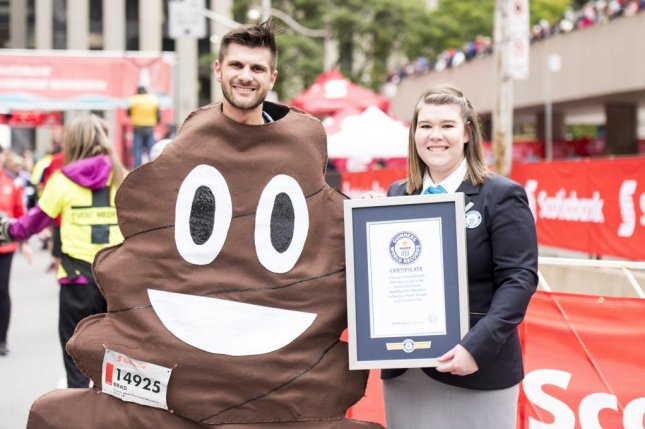Guinness adjudicators were on hand to present certificates for 13 broken records at the 2018 Scotiabank Toronto Waterfront Marathon. Photo courtesy of Guinness World Records/Canada Running Series