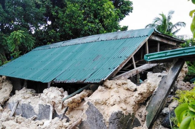 A house is severely damaged in Itbayata, Philippines, after earthquakes ranging from magnitude 5.4 to 5.9 struck the northern province Saturday. Photo by Obet Garcia Nico/EPA