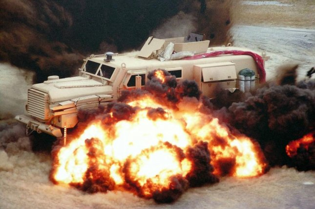 Armored vehicles used by the U.S. Marines and Air Force are set to be upgraded. Pictured, landmines explode around an MRAP vehicle. U.S. Department of Defense photo