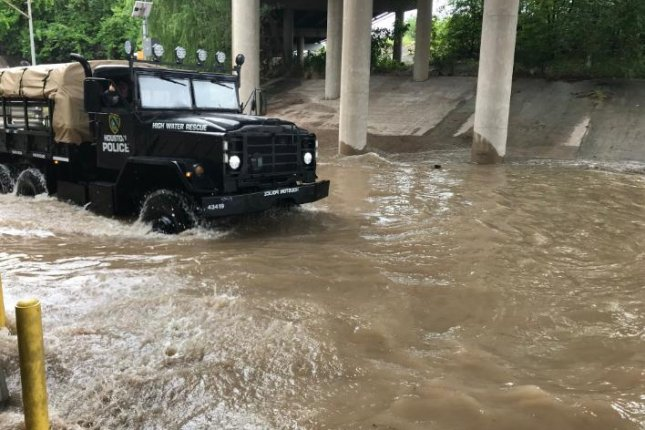 Houston police responded to more than 125 calls from stranded motorists Wednesday after a storm dumped 8 inches of rain on parts of the city. Photo courtesy of Larry Satterwhite/Houston Police/Twitter