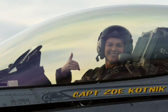 """Capt. Zoe """"SiS"""" Kotnik, commander of the Viper Demonstration Team, smiles after a certification flight at Joint Base Langley-Eustis, Va., on Tuesday. Photo by Senior Airman Kathryn R.C. Reaves/U.S. Air Force/Twitter"""
