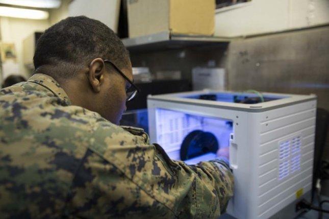 Marine Corps Sgt. Adrian Willis, a computer and telephone technician with Combat Logistics Battalion 31, 31st Marine Expeditionary Unit, prepares to print a 3D model aboard the USS Wasp. Photo by Cpl. Bernadette Wildes/U.S. Marine Corps