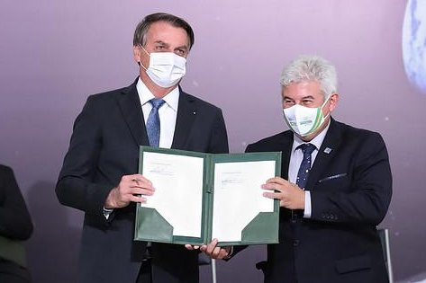 Brazilian President Jair Bolsonaro (L) with Brazil's Minister of Science, Technology and Innovation Marcos Pontes hold up the Artemis Accords after signing the document on Tuesday during a ceremony at the Palacio do Planalto in Brasilia on Tuesday. Photo courtesy of NASA's Artemis Program/Twitter
