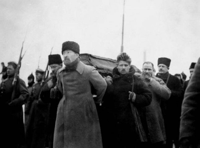 Pallbearers Carrying Vladimir Lenin's Coffin during his funeral, from Paveletsky Station to the Labor Temple. Felix Dzierżyński at the front with with Timofei Sapronov behind him and Lev Kamenev at left. Photo courtesy of Wikipedia.