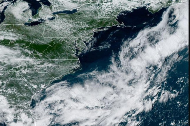 A disturbance moving along a cold front in the southeastern United States is being monitored for strengthening this week. This front is part of the same system that absorbed Tropical Rainstorm Laura. Photo courtesy National Oceanic and Atmospheric Administration.