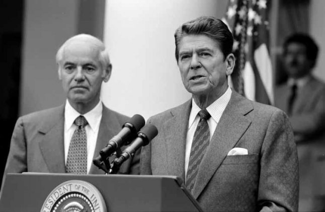President Ronald Reagan with William French Smith making a statement to the press regarding the air traffic controllers strike (PATCO) from the Rose Garden on August 3, 1981. Photo courtesy The White House
