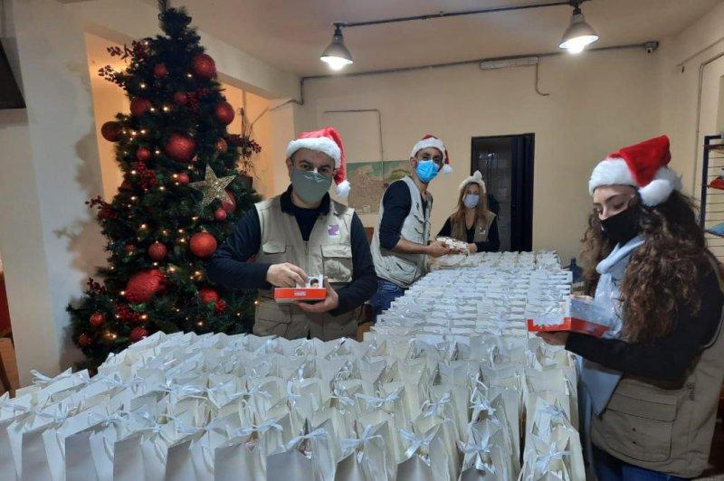 People from the Beit el Baraka charity fill gift bags. Photo courtesy ofBeit el Baraka