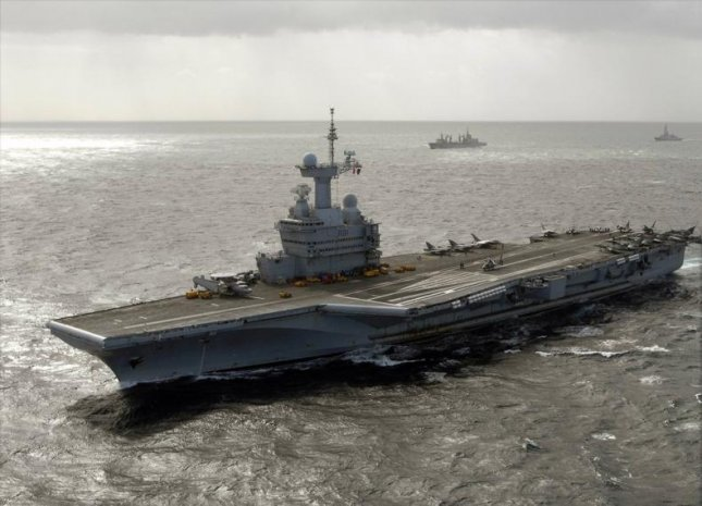French President Francois Hollande announced the loan of artillery to Iraqi forces, and a return to the region of the aircraft carrier Charles de Gaulle, to help fight the Islamic State. Photo courtesy of the U.S. Navy.