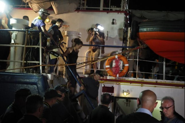 Migrant ship captain detained after ramming Italian police boat