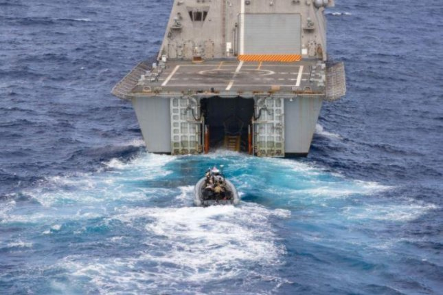The USS Sioux City drops an 11-meter inflatable boat during anti-smuggling exercises with the navy of the Dominican Republic on Sunday. Photo by MCS2 Marianne Guemo/U.S. Navy