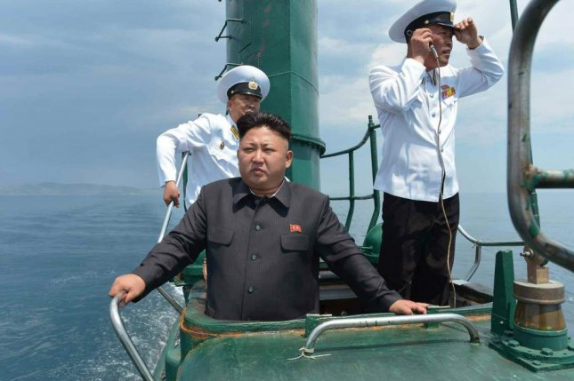 Kim Jong Un on board a North Korean submarine in 2014. A new manual for North Korean schoolteachers claims Kim exhibited outstanding talent in navigating boats and cars at an early age. Photo by Rodong Sinmun/Yonhap