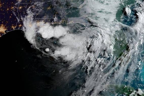 This image from early Wednesday shows thunderstorms gathering over the northern Gulf of Mexico. Image courtesy of  NOAA
