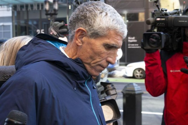 William Rick Singer, pictured here leaving a Boston federal courthouse in March, ran an operation that was at the center of Operation Varsity Blues, prosecutors say. File photo by CJ Gunther/EPA-EFE