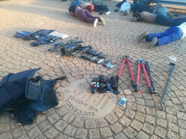 Police seized several firearms and arrested suspects in a hostage situation Saturday at International Pentecost Holiness Church. Photo courtesy of South African Police Service