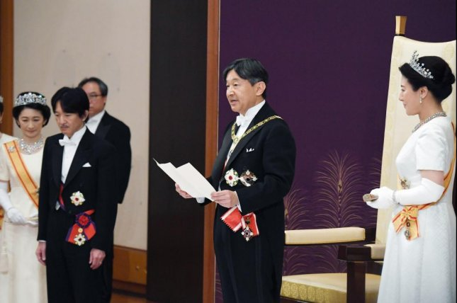 Japan's new Emperor Naruhito (C) and Empress Masako (R) attend the First Audience Wednesday after the accession to the throne at the Imperial Palace in Tokyo, Japan. Photo by EPA-EFE/JIJI PRESS