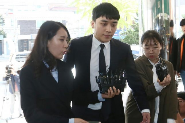 South Korean celebrity Seungri (C) may have been in contact with a senior police officer while he operated Burning Sun, a nightclub where victims were routinely raped and drugged. File Photo by Kim Chul-soo/EPA-EFE