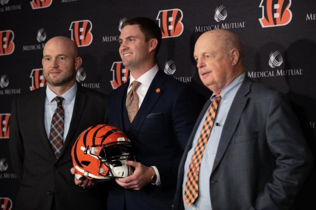 New Cincinnati Bengals head coach Zac Taylor (C) finalized his 2019 coaching staff Thursday by hiring two assistants. He was introduced on Feb. 5 by Bengals director of player personnel Duke Tobin (L) and owner Mike Brown. Photo courtesy of the Cincinnati Bengals/Twitter
