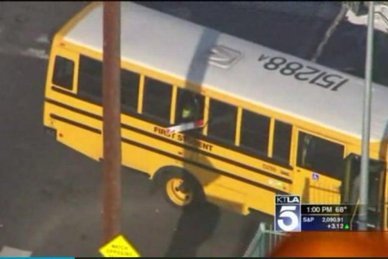 A railroad crossing arm impales a school bus in Los Angeles. Sceeenshot: KTLA-TV