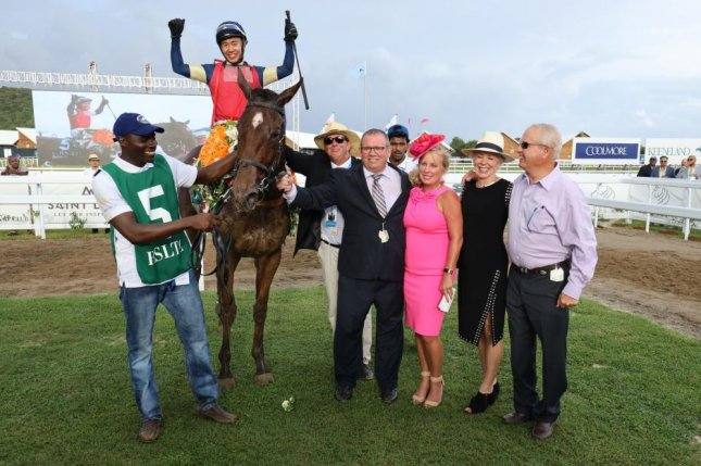 Winning connections celebrate after the inaugural running of the Royal Saint Lucia Turf Club's $150,000 Pitons Cup on Friday. Photo courtesy of Royal Saint Lucia Turf Club