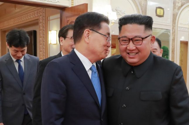 Kim Jong Un (R) has responded positively to a letter from South Korea, delivered to him by Seoul's national security adviser Chung Eui-yong. File Photo courtesy of Republic of Korea presidential office Cheong Wa Dae