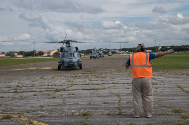 A U.S. Navy helicopter arrived at Maxwell AFB, Ala., on Wednesday after it was evacuated from Naval Station Mayport, Fla., ahead of Hurricane Dorian. Photo by Billy Burchfield/U.S. Navy