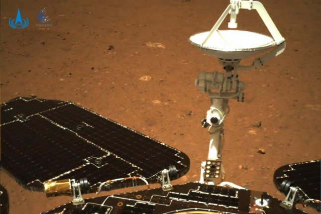 A photo from the Martian surface shows theZhurong rover's solar panels and antenna unfolding. Photo courtesy of China National Space Administration