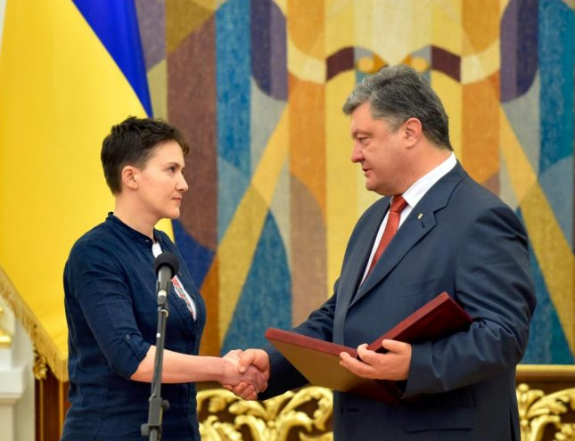 First Lt. Nadiya Savchenko received the Gold star of Hero of ukraine award, and a welcome home from Ukrainian President Petro Poroshenko, Friday in kiev after her return from Russian captivity. She said she would welcome the opportunity to become president. Photo courtesy of Ukrainian Ministry of Defense
