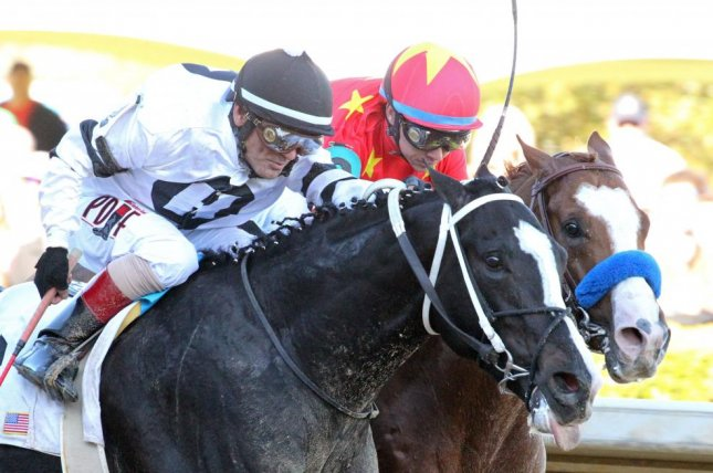 Long Range Toddy edges Improbable in the first division of the Rebel Stakes at Oaklawn Park. Photo courtesy of Oaklawn Park