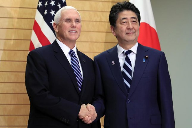 U.S. Vice President Mike Pence (L) shakes hands with Japanese Prime Minister Shinzo Abe (R) at the start of their meeting at the prime minister's official residence in Tokyo on Tuesday. Photo by Franck Robichon/EPA-EFE
