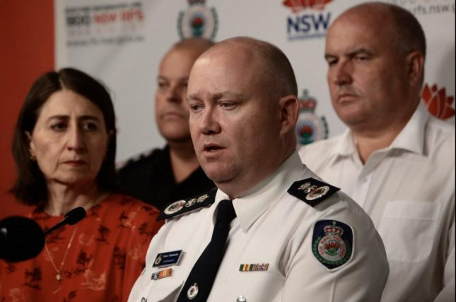 NSW RFS Commissioner Shane Fitzsimmons (R) and NSW Premier Gladys Berejiklian (L) announced the deaths of three American fighters during a press conference Thursday. Photo courtesy of NSW Premier Gladys Berejiklian/Twitter