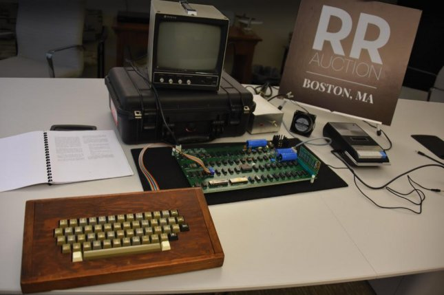 An Apple-1 computer with its original box signed by co-creator Steve Wozniak is being auctioned online with a starting bid of $50,000. Photo courtesy of RR Auctions