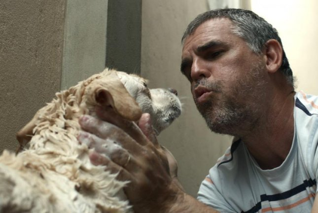 Father Joao rescues dogs in Brazil. Photo courtesy of Netflix