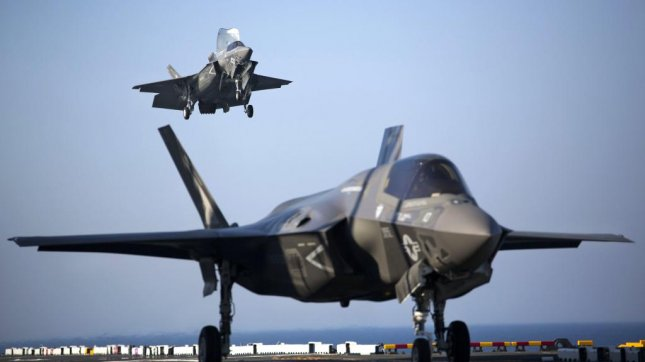 Two F-35B Lightning II Joint Strike Fighters complete vertical landings aboard the USS Wasp (LHD-1) during the opening day of the first session of operational testing, May 18, 2015. As the future of Marine Corps aviation, the F-35B will eventually replace all aircraft from three legacy Marine Corps platforms: the AV-8B Harrier, the F/A-18 Hornet and the EA-6B Prowler. The aircraft are stationed with Marine Fighter Attack Training Squadron 501, Marine Aircraft Group 31, 2nd Marine Aircraft Wing, Beaufort, South Carolina and Marine Fighter Attack Squadron 121, Marine Aircraft Group 13, 3rd Marine Aircraft Wing, Yuma, Arizona. Photo by Lance Cpl. Remington Hall/U.S. Marine Corps