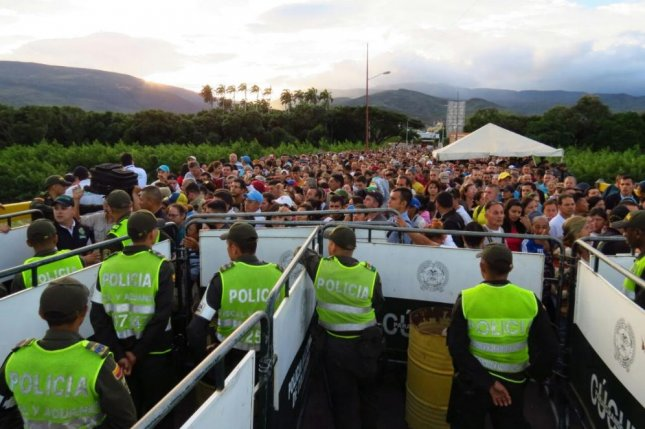 Colombian officials sent 43 trucks full of basic goods to the Norte de Santander province after more than 120,000 Venezuelans crossed the border into Colombia to purchase basic goods. Photo courtesy of Colombian National Police