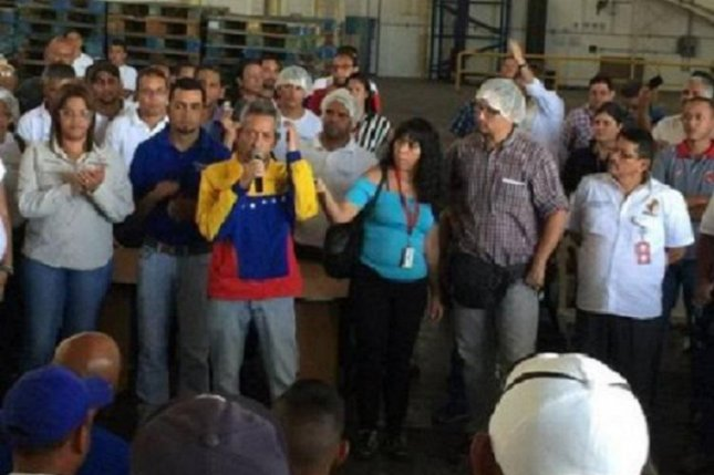 Venezuelan Labor Minister Oswaldo Vera on Monday seized a factory owned by Kimberly-Clark, a U.S. company, after production was halted over the weekend due to a lack of raw materials. Vera, seen here speaking to a crowd within the factory in Maracay, said the closure of the plant was illegal because the company fired nearly 1,000 workers without first consulting the government. Photo courtesy of Ministry of Popular Power for Social Work Process