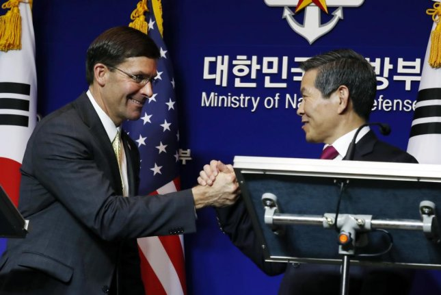 U.S. Secretary of Defense Mark Esper (L) and South Korean Minister of National Defense Jeong Kyeong-doo (R) shake hands during a press conference after their meeting at the Ministry of National Defense in Seoul, South Korea, on Friday. Photo by Jeon Heon-kyun/EPA-EFE