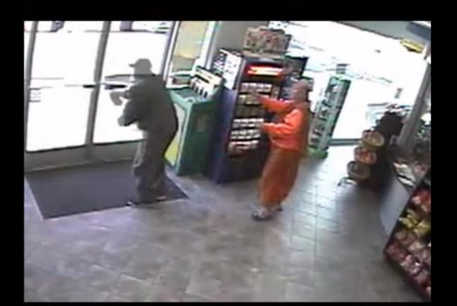 The robber flees after grabbing a Buddhist monk's wallet at a Sunoco station in Philadelphia. PhiladelphiaPolice/YouTube video screenshot