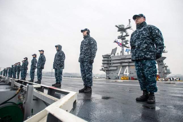 Sailors stand on the the deck of the USS John C. Stennis prior to a regularly scheduled deployment. Photo courtesy of U.S. Navy