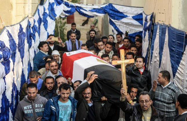 People carry a coffin as relatives of the victims of an attack at the Coptic Christian cathedral in Cairo, Egypt, on December 11, 2016. The Islamic State took credit for sending the suicide bomber to the church, where he set off an explosion that killed 25 and injured dozens. Photo by Mohamed Hossam/European Pressphoto Agency EPA/MOHAMED HOSSAM
