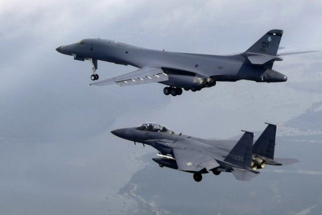 A handout photo made available by the South Korean Air Force shows a U.S. B1-B bomber (top) escorted by South Korean F-15K fighters as they fly over South Korea during a 10-hour mission from Andersen Air Force Base, Guam, into Japanese airspace and over the Korean peninsula, on Sunday. North Korea condemned the flight Monday. File Photo by Republic of Korea Air Force/EPA