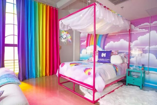 The Lisa Frank Flat, available for single-night stays starting Oct. 11 in Los Angeles, features illustrations by the artist, best known for designing school supplies in the 1990s. Photo courtesy of Hotels.com