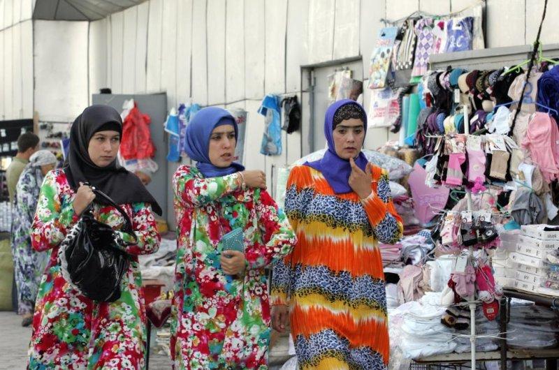 Tajik women walk at the Firdavsi street, Dushanbe, Tajikistan on August 6, 2012. Last month, the Tajik government passed a law that aims to discourage women from wearing the hijab. File photo by Igor Kovalenko/EPA