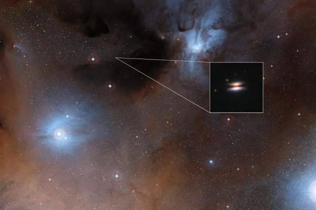 The Flying Saucer protoplanetary disc appears edge-on from Earth. Photo by ESO/ALMA