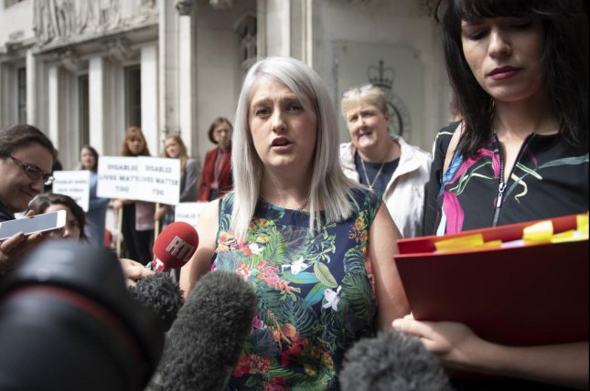 Sarah Ewart (C) shown outside the Supreme Court in London in 2018. The High Court in Belfast ruled Thursday that the region's abortion laws violated Britain's human rights commitment. File Photo by Will Oliver/EPA-EFE