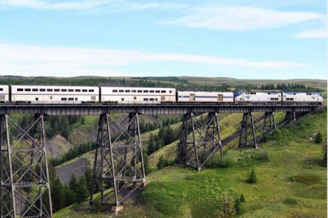 An eastbound Amtrak Empire Builder crosses Two Medicine Trestle at East Glacier, Mont., on July 20, 2011. An Empire Builder train, which runs between Chicago and Seattle, derailed in Joplin, Mont., Saturday. File photo courtesy Amtrak