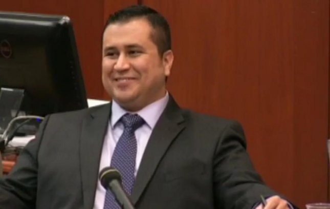 George Zimmerman laughs in court during testimony on lethal force, Wednesday July 3. (Screenshot via Fox News)