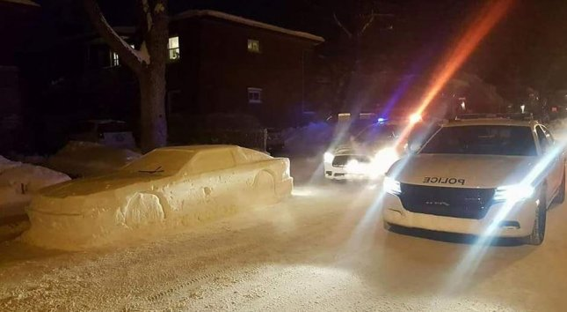 Simon Laprise built a Delorean out of snow and got a parking ticket. Photo by Laprise Simon Designs